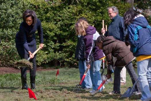 The First Lady and elementary school kids break ground for the new White House Kitchen Garden.